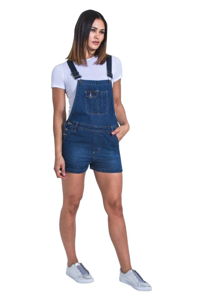 Full front view of model wearing 'Imogen' style, dark wash denim dungaree shorts from Dungarees Online.