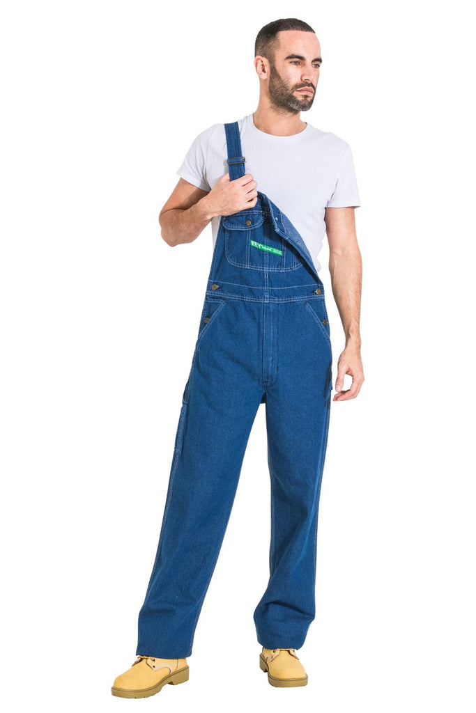 Full-length frontal view with left strap detached, wearing relaxed-fit, stonewash dungaree.