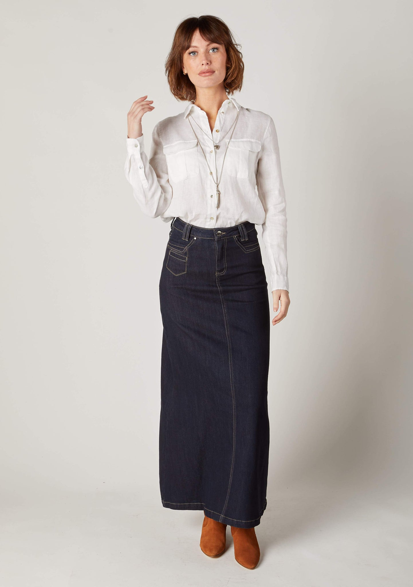 Full length frontal front view of flattering maxi-denim denim skirt from Dungarees Online.