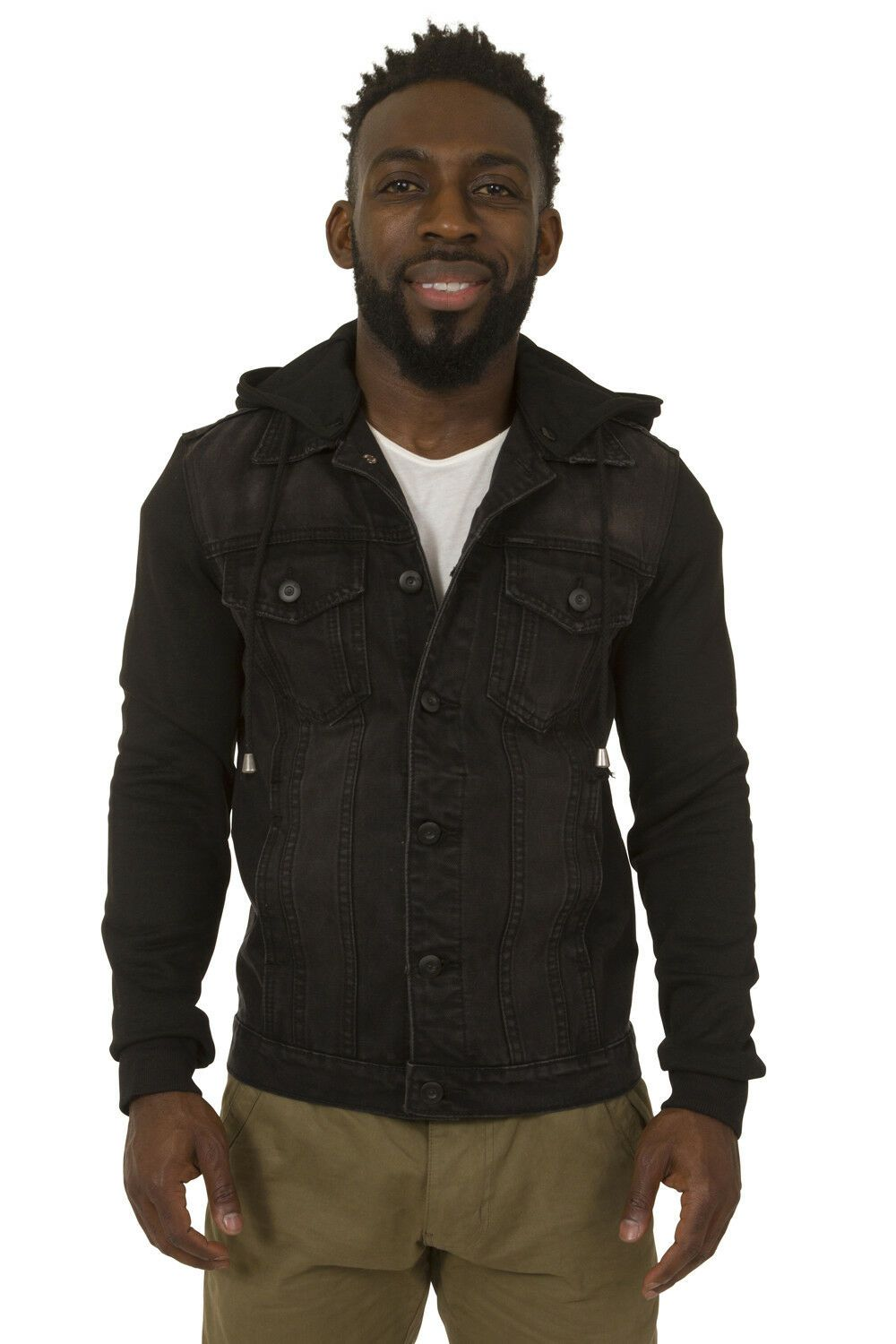 Close frontal view of close-fitting black denim jacket with view of front and breast pockets and cotton jersey sleeves.
