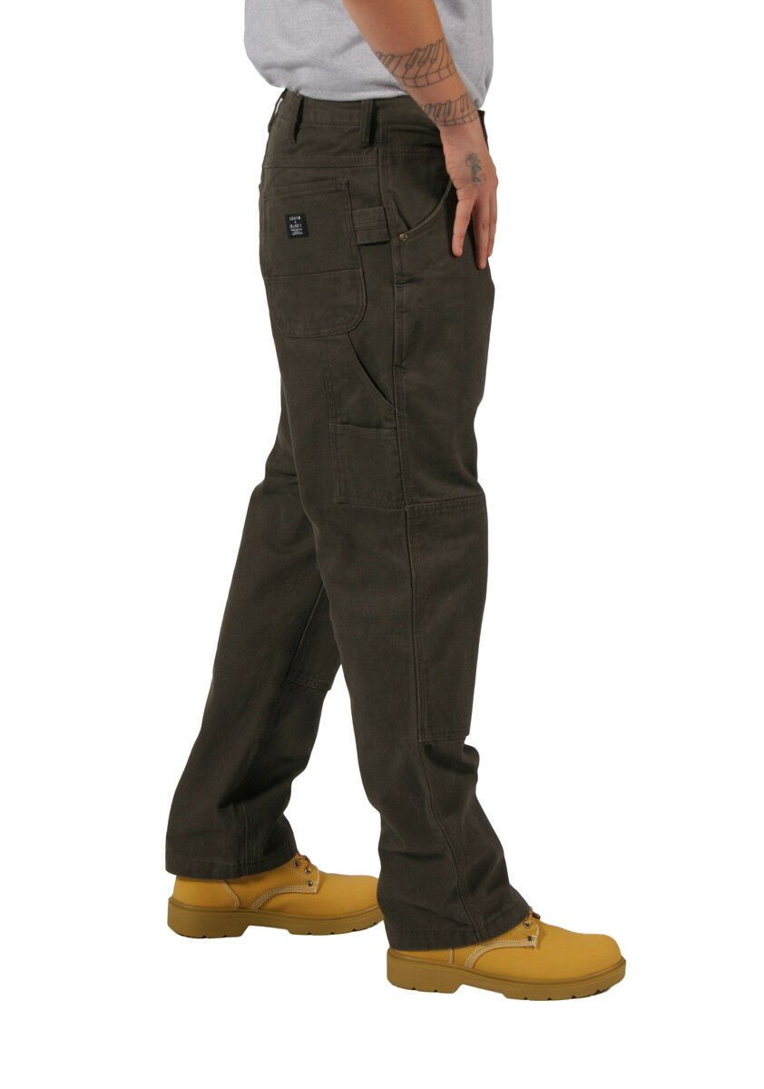 Side view facing left wearing premium work trousers showing seams and pockets.