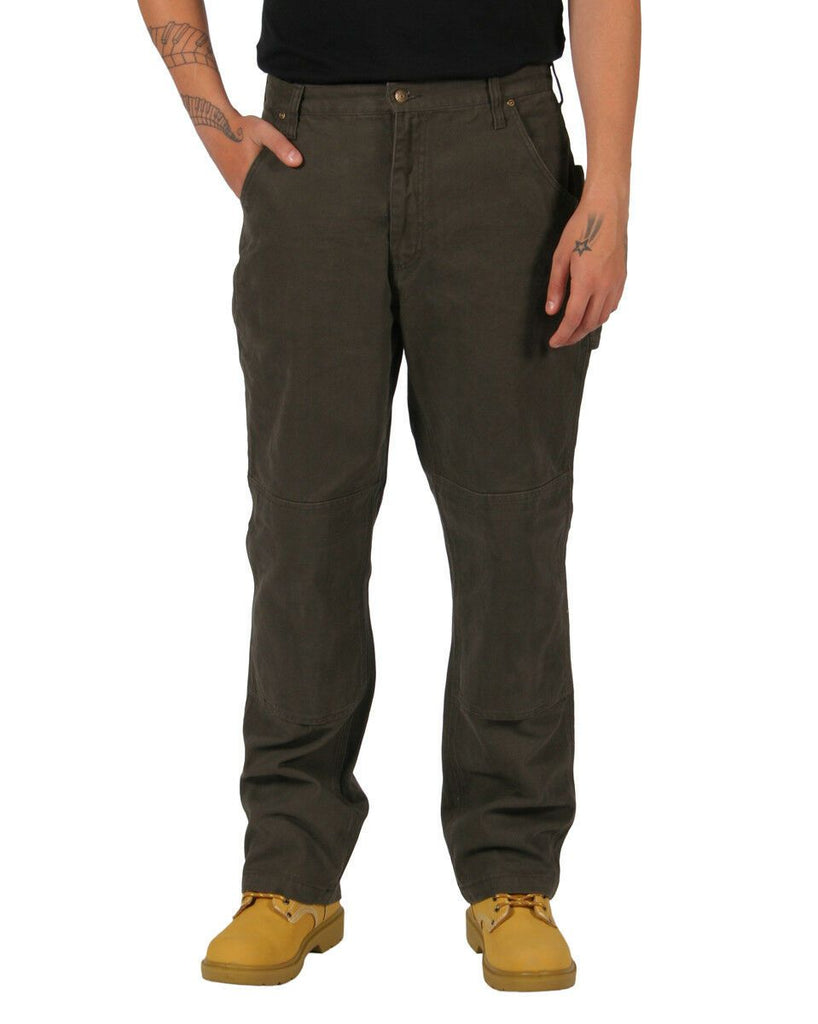 Frontal view wearing brown 'KEY Industries' duck fabric work trousers in brown, made from premium materials.