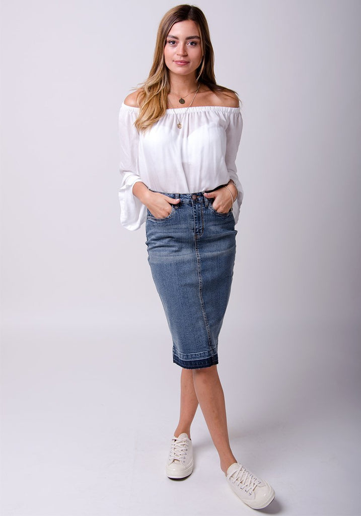 Full-front pose with legs crossed, wearing stretch denim pencil skirt.