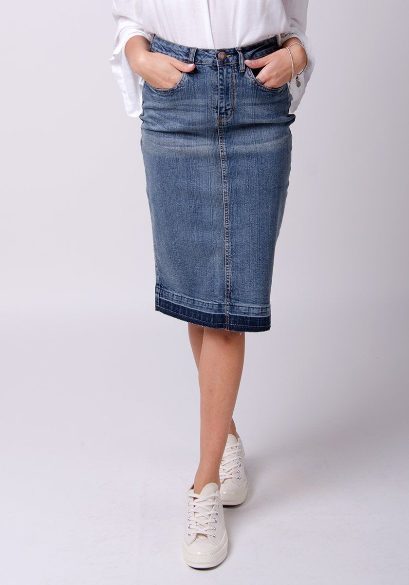 Frontal bottom-half pose wearing midwash blue stretch denim skirt.