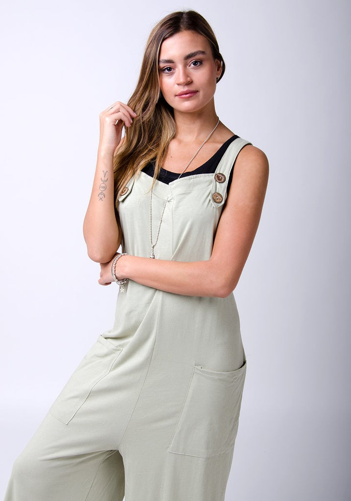 Frontal half-length pose wearing WASH brand, pale-green, cotton jersey dungarees.