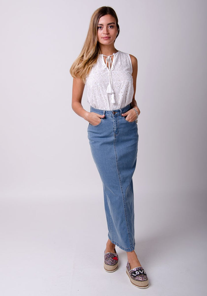 Full frontal pose with hands in front pockets wearing Dungarees Online's straight denim skirt.