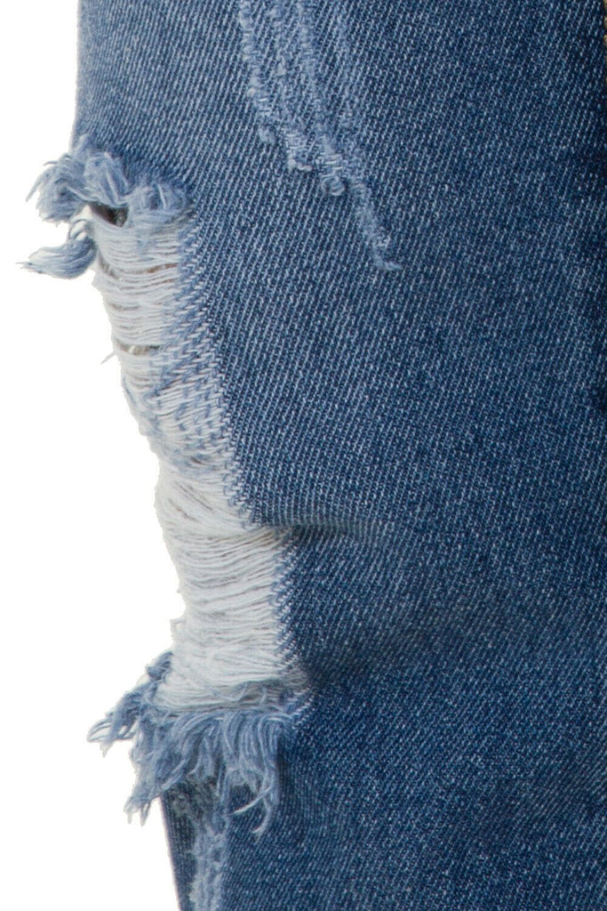 Close up of a distressed-fatigue feature on cotton-terylene dungaree material.