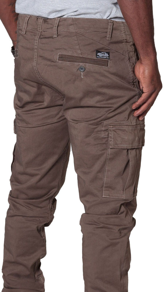 Angled rear focus of cargo trousers, with clear view of stitching, rear and cargo pockets and slightly stretchy brown material.