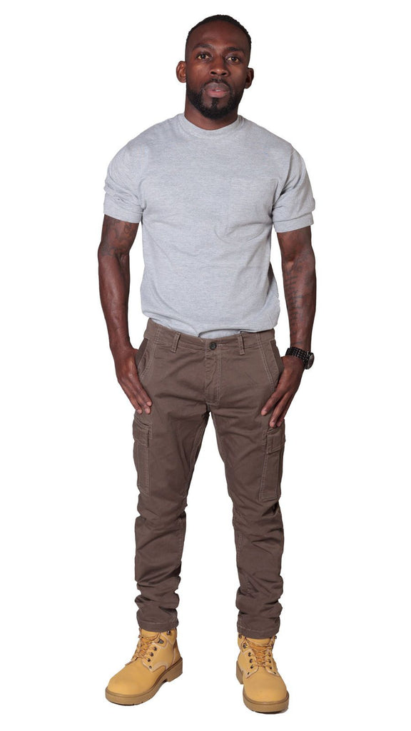 Full frontal view of 'Pete' style, casual cotton mix cargo trousers in brown with thumbs in front pockets and view of belt loops and zip fly.