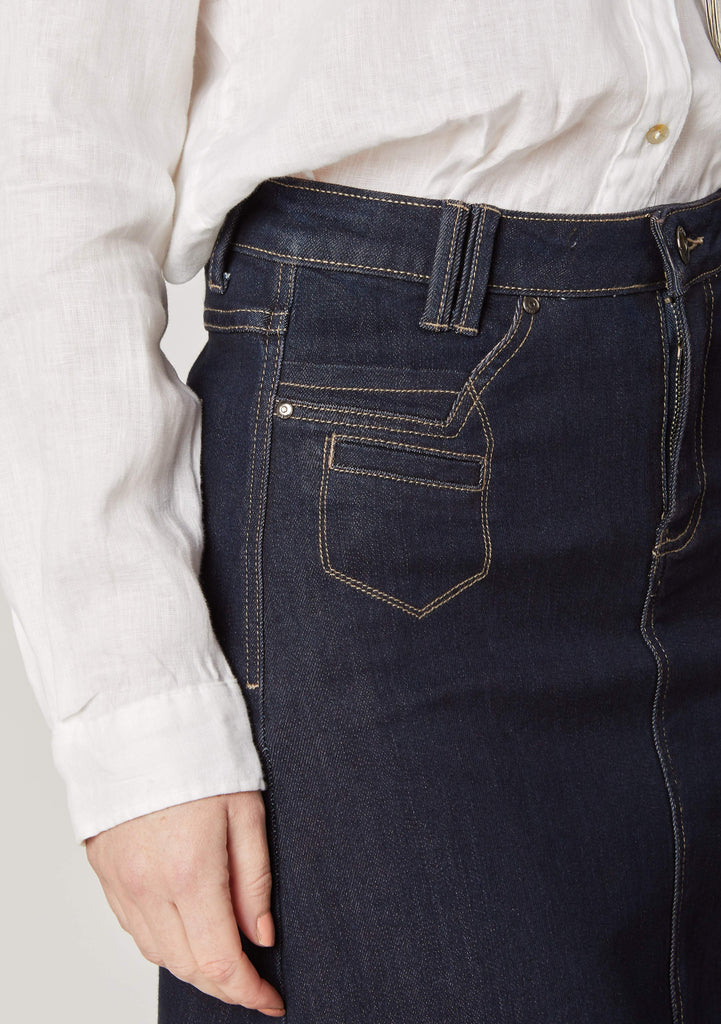 Close-up view of 'Natalie' maxi denim skirt front pockets with focus on belt loops, zip and button closure.