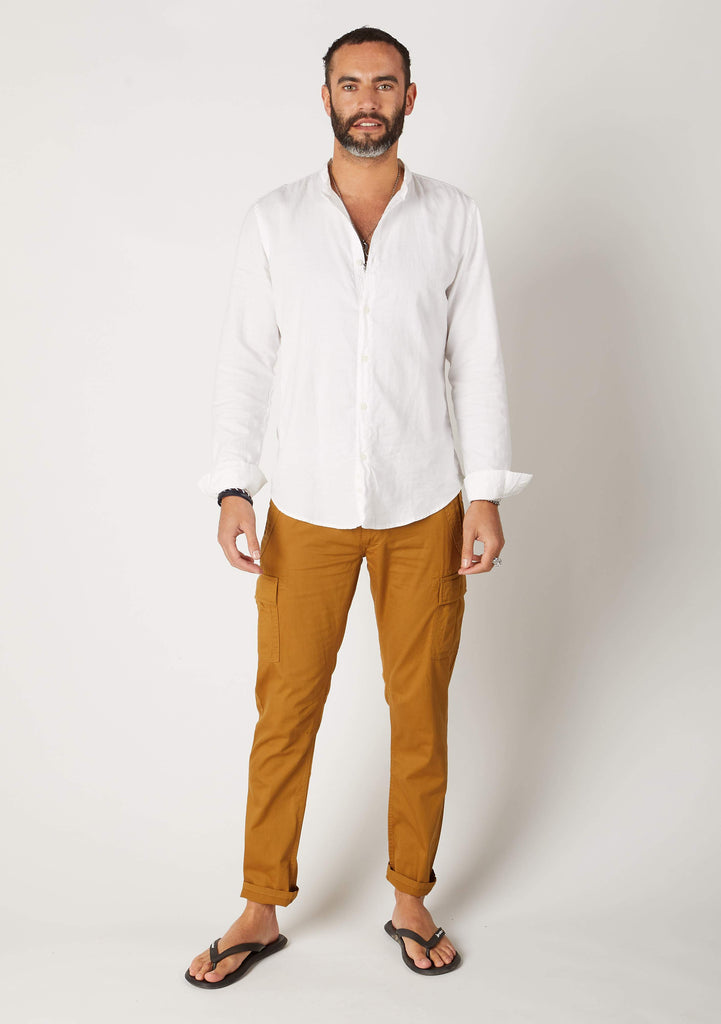 Full-length frontal pose wearing 'Radcliffe' style men's dull-gold organic cotton slim fit cargo trousers.