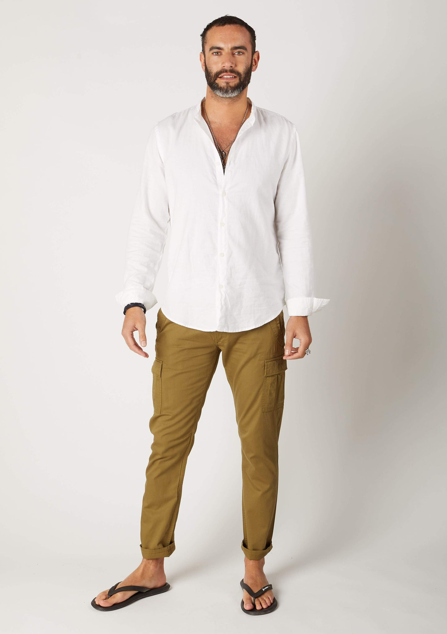 Full-length frontal pose wearing 'Radcliffe' style men's olive organic cotton slim fit cargo trousers.