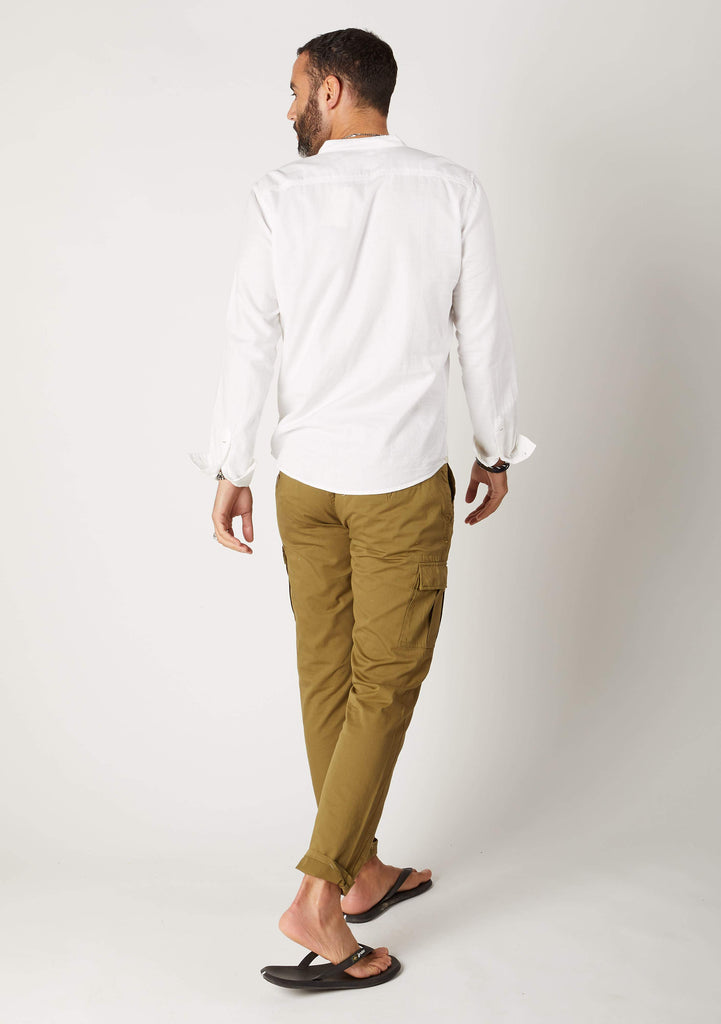Full-length angled rear pose looking left, wearing olive cargo pants with view of cargo pockets.