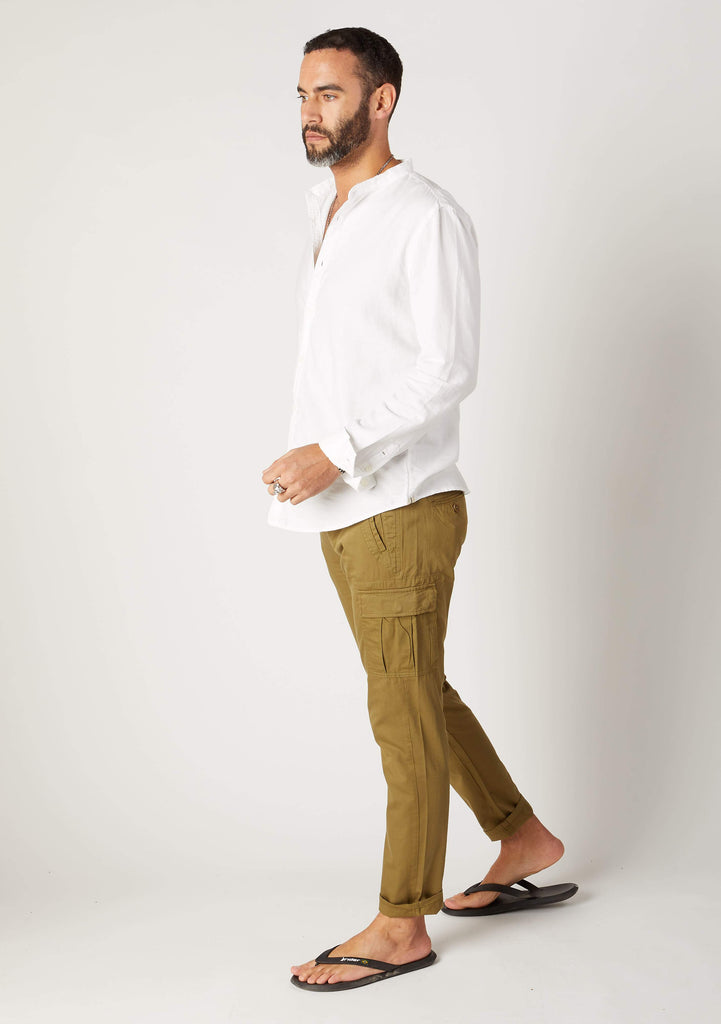 Full-length side walking pose, wearing olive cargo pants with view of cargo pockets.