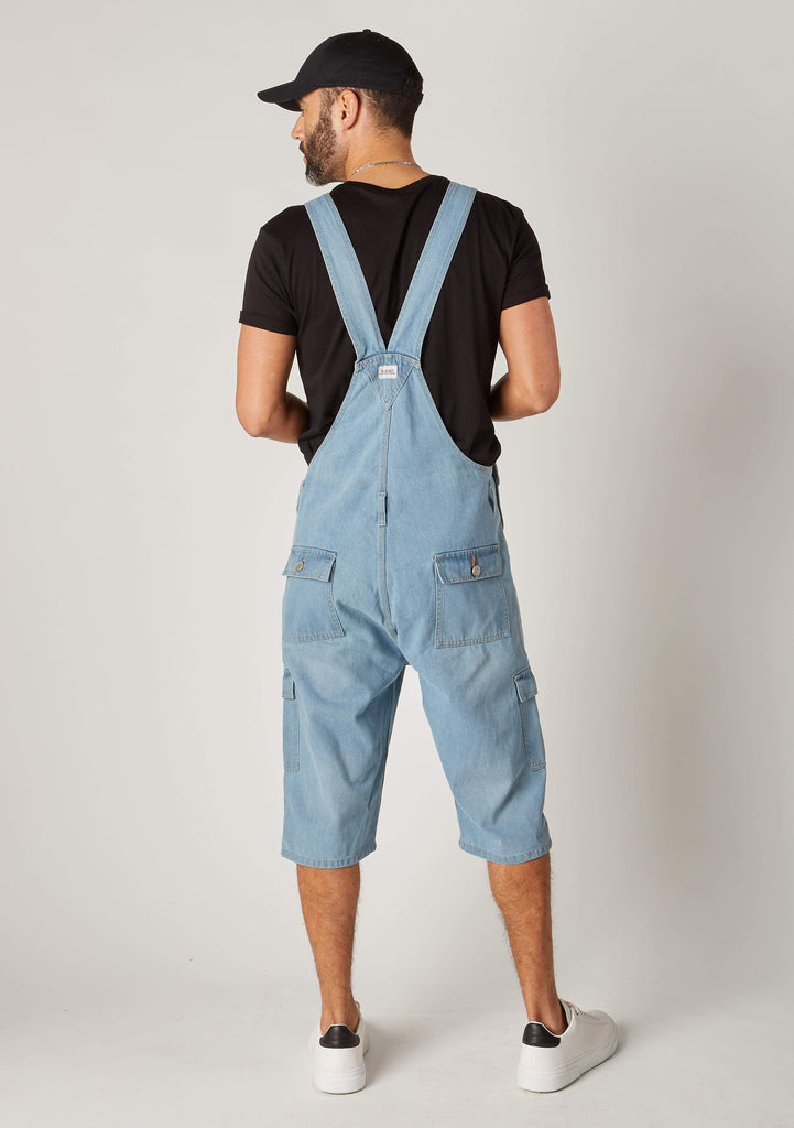 Rear pose wearing 'Blake' brand palewash bib overalls shorts from Dungarees Online.
