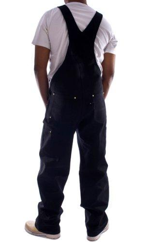 Rear pose with thumbs in reinforced pockets, wearing Carhartt R01 black denim dungarees.