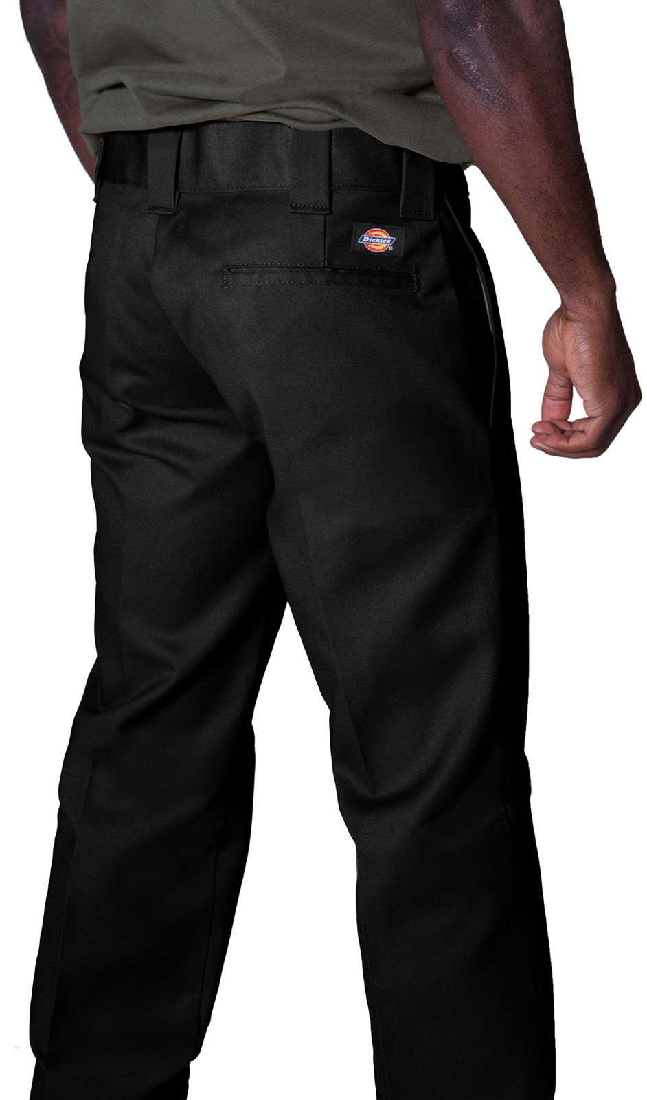 Close-up back view of black twill fabric work pants showing 'Dickies' logo, back pocket and belt loops.