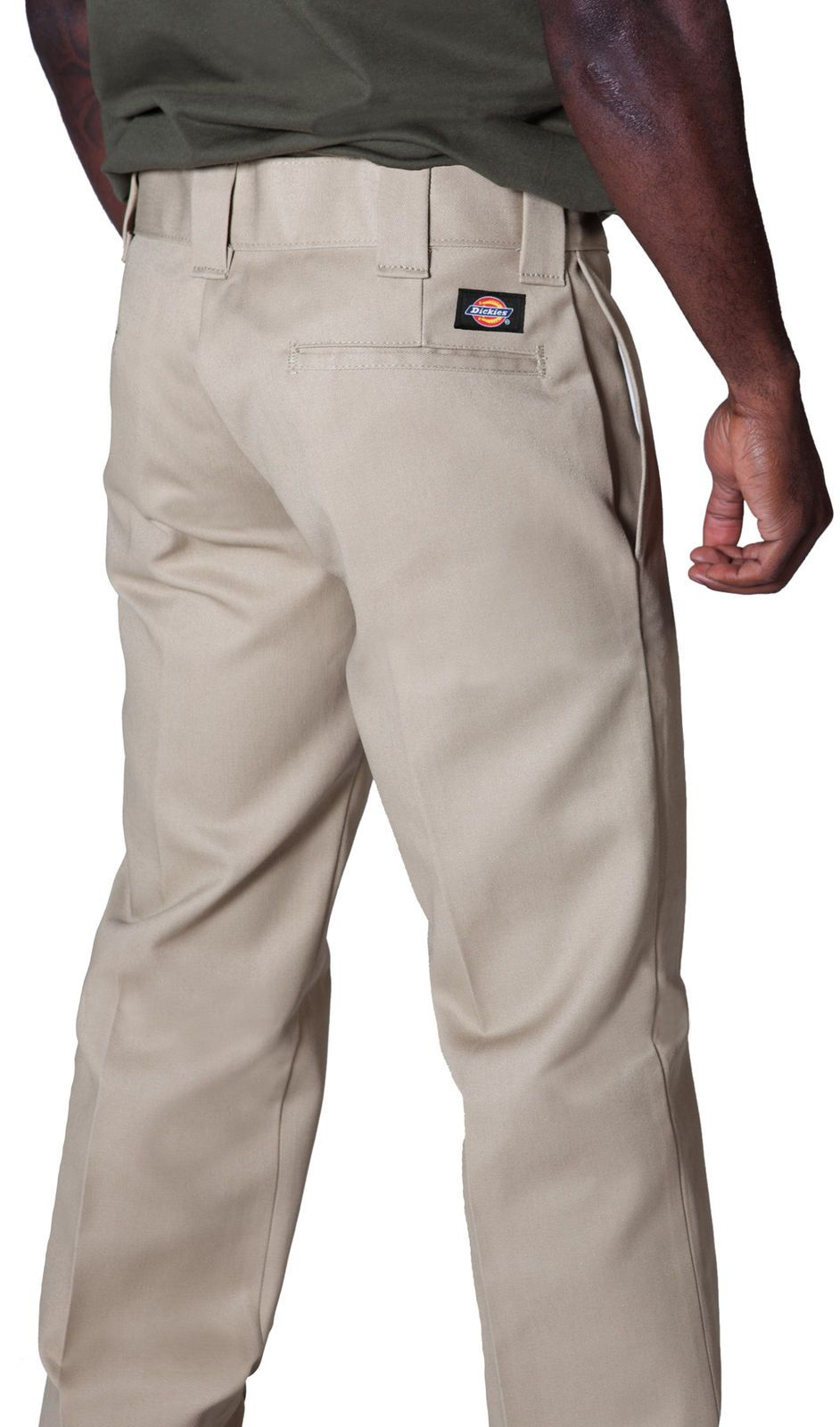 Close-up angled back view of khaki twill fabric work pants showing 'Dickies' logo, back pocket and belt loops.