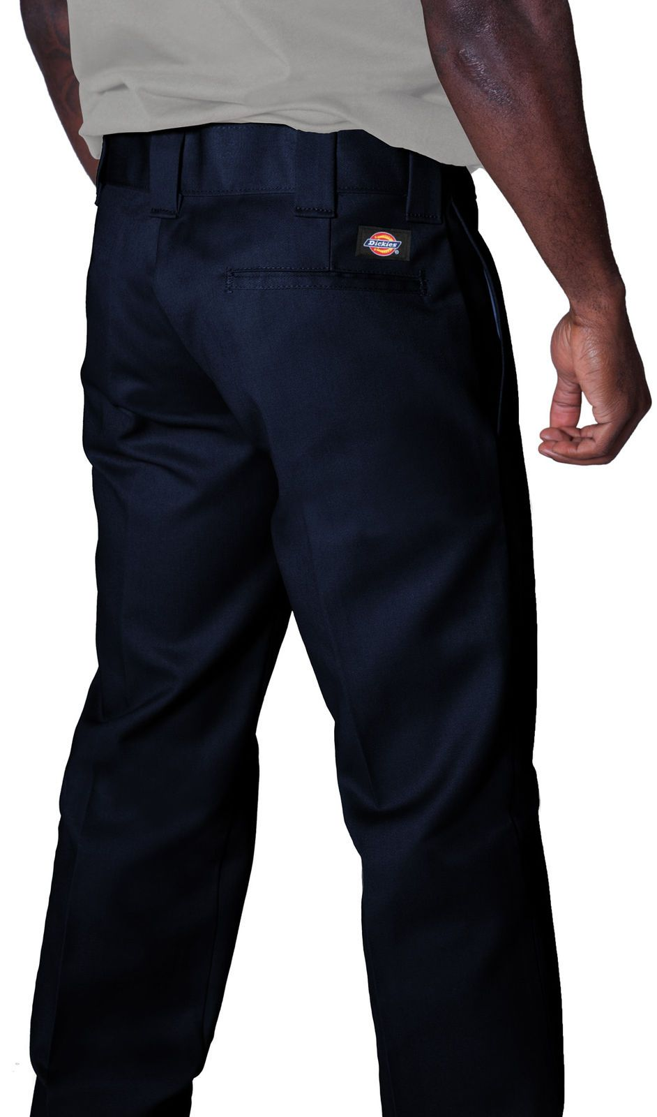 Close-up angled back view of navy twill fabric work pants showing 'Dickies' logo, back pocket and belt loops.