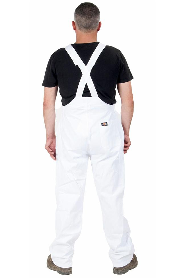 Full back pose with Dickies white work overalls with elasticated straps.