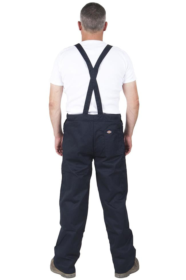 Full back pose with Dickies dark work overalls with adjustable straps.