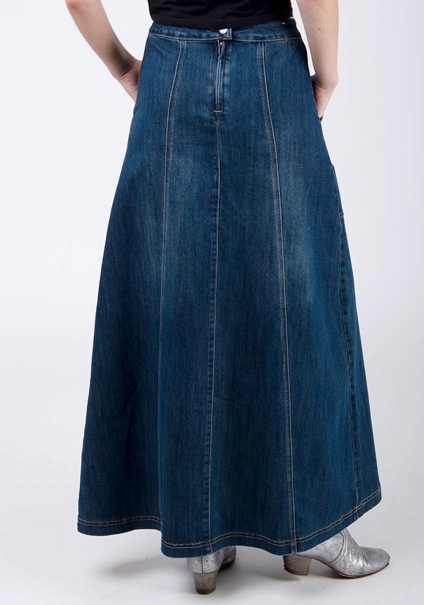 Two-thirds rear pose wearing A-line flared skirt in vintage-wash denim, focussing on denim texture, back zip and seams.