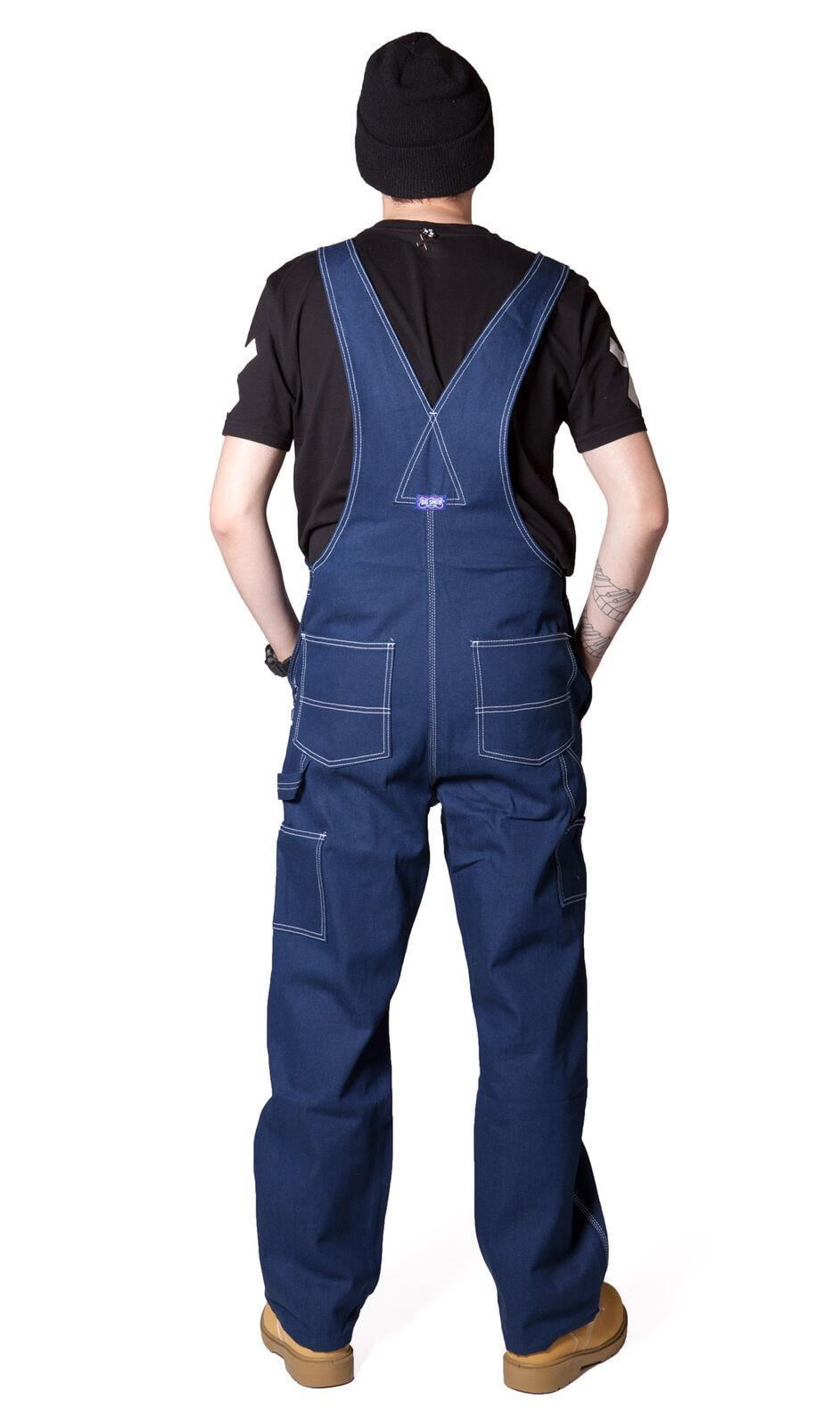 Rear pose wearing 'Big Smith' brand indigo bib overalls from Dungarees Online.