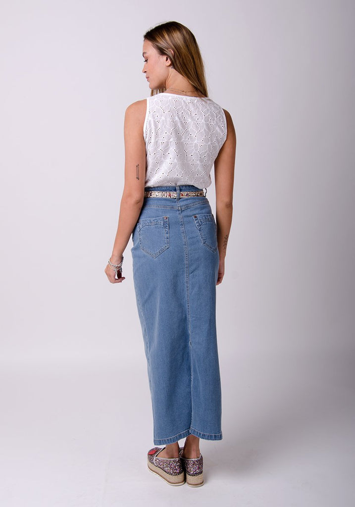 Full-rear pose showing back split and pockets of long, straight denim skirt.
