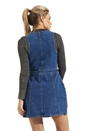 Top-half back view of fitted sleeveless short jean dress in midwash denim.