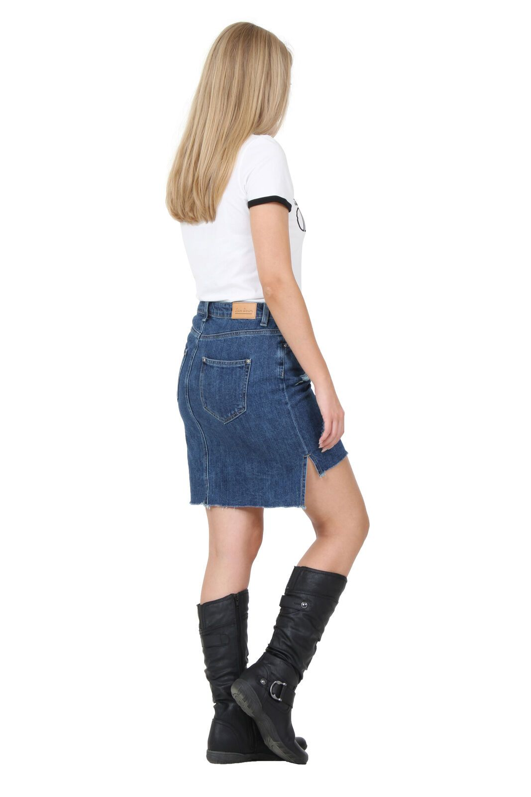 Angled back-side view wearing short denim skirt, clearly illustrating longer back and shorter front.
