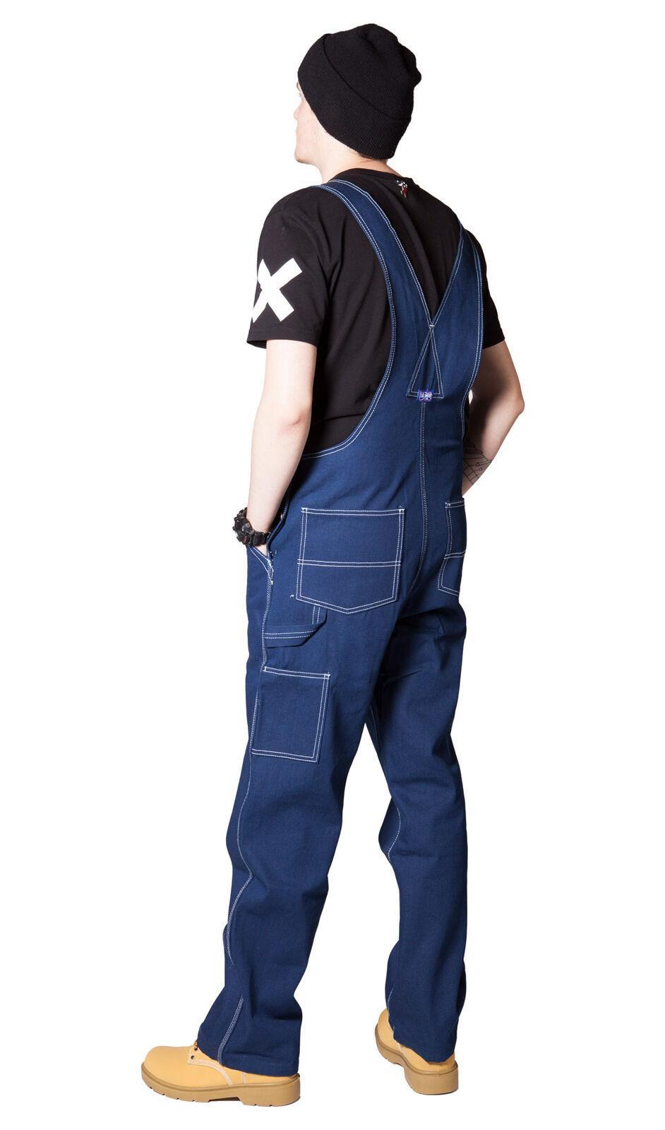 Angled full rear pose wearing 'Big Smith' brand cotton bib overalls from Dungarees Online.