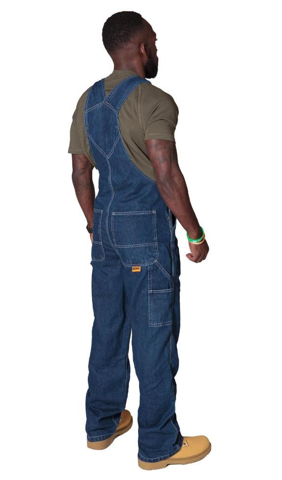 Rear pose wearing 'Berne' brand stonewash bib overalls from Dungarees Online.