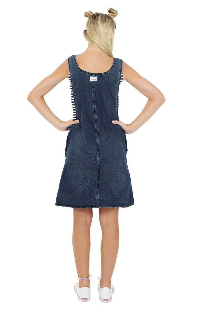 Full-length view showing elegant silhouette of short denim pinafore sleeveless jean dress.