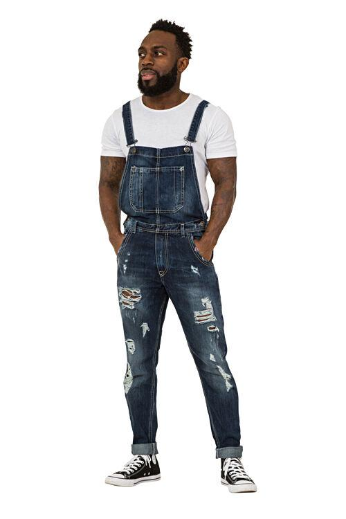 Full frontal facing slightly to his right wearing 'Alan' brand Mens Destroyed Denim Dungarees.