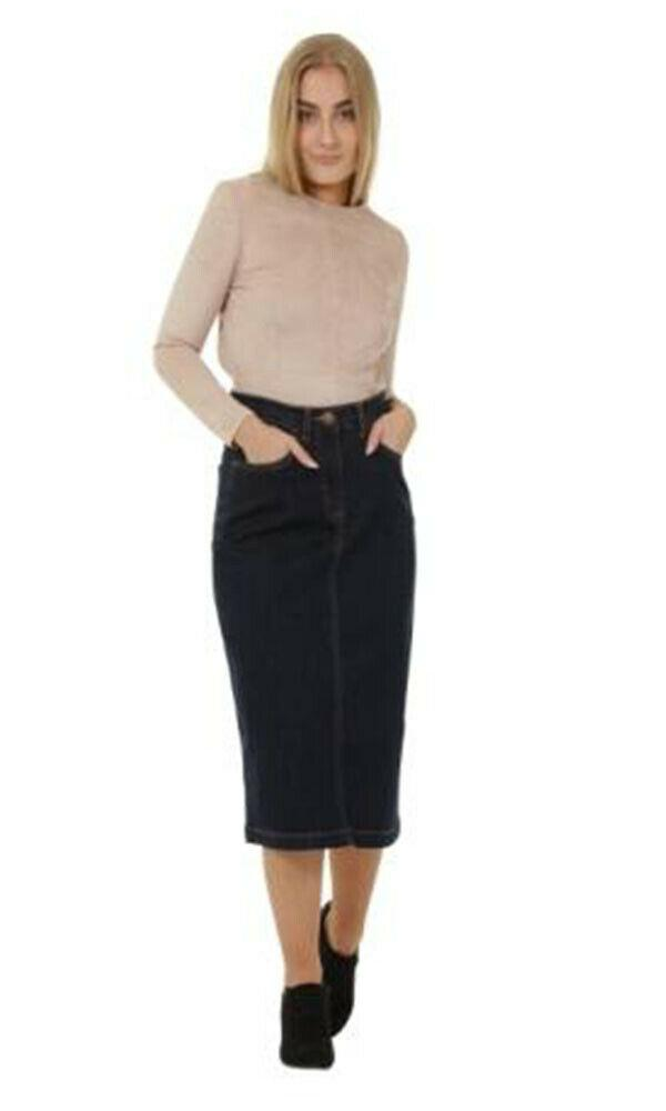 Full frontal with hands in front pockets of classic 'Samantha' denim midi skirt with stretch.