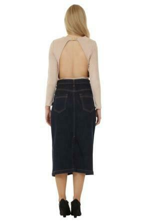Full back view showing stretch of the denim and rear pockets of skirt, paired with backless fawn top.