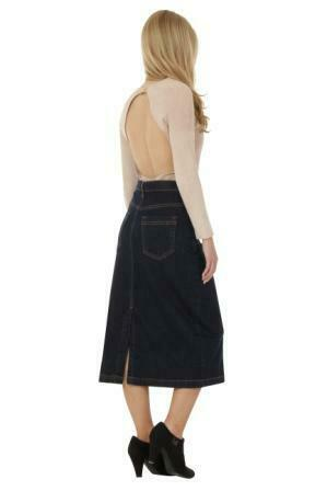 Full angled side view of calf-length, dark denim skirt, showing back split.