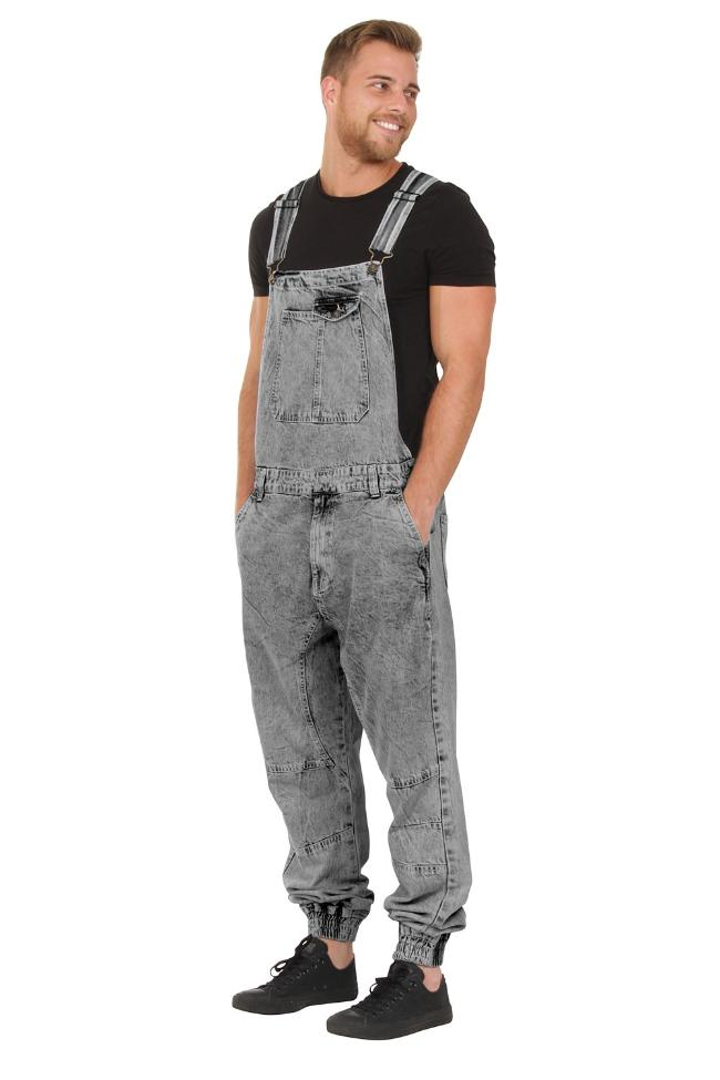 Front-side view of model with hands in front pockets of dark, acid wash dungarees.