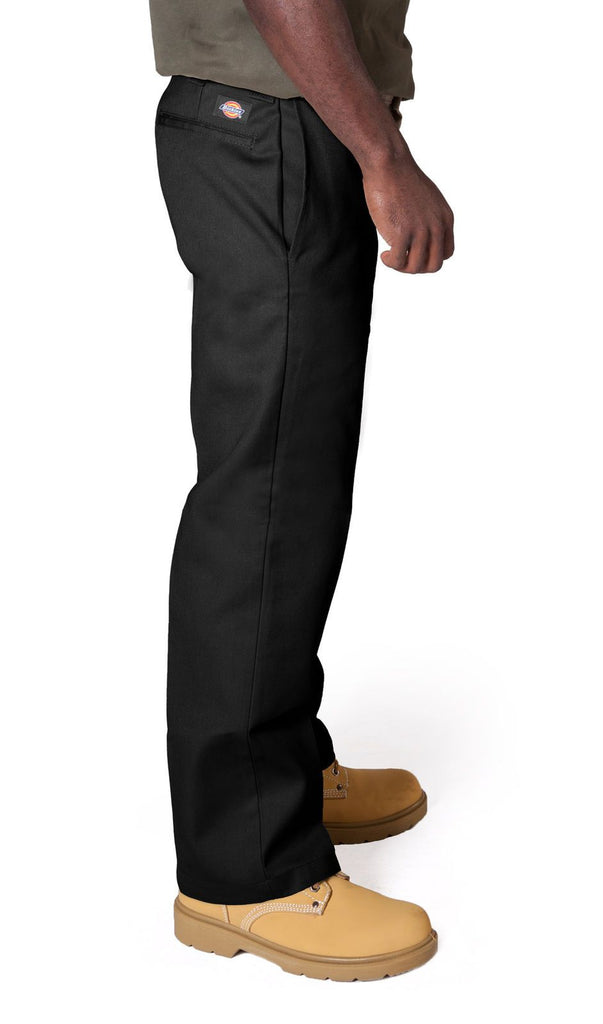 Close side view of slim and straight cut work trousers in black showing 'Dickies' logo, side pockets and belt loops.