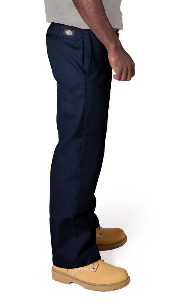 Close side view of slim and straight cut work trousers in navy showing 'Dickies' logo, side pockets and belt loops.