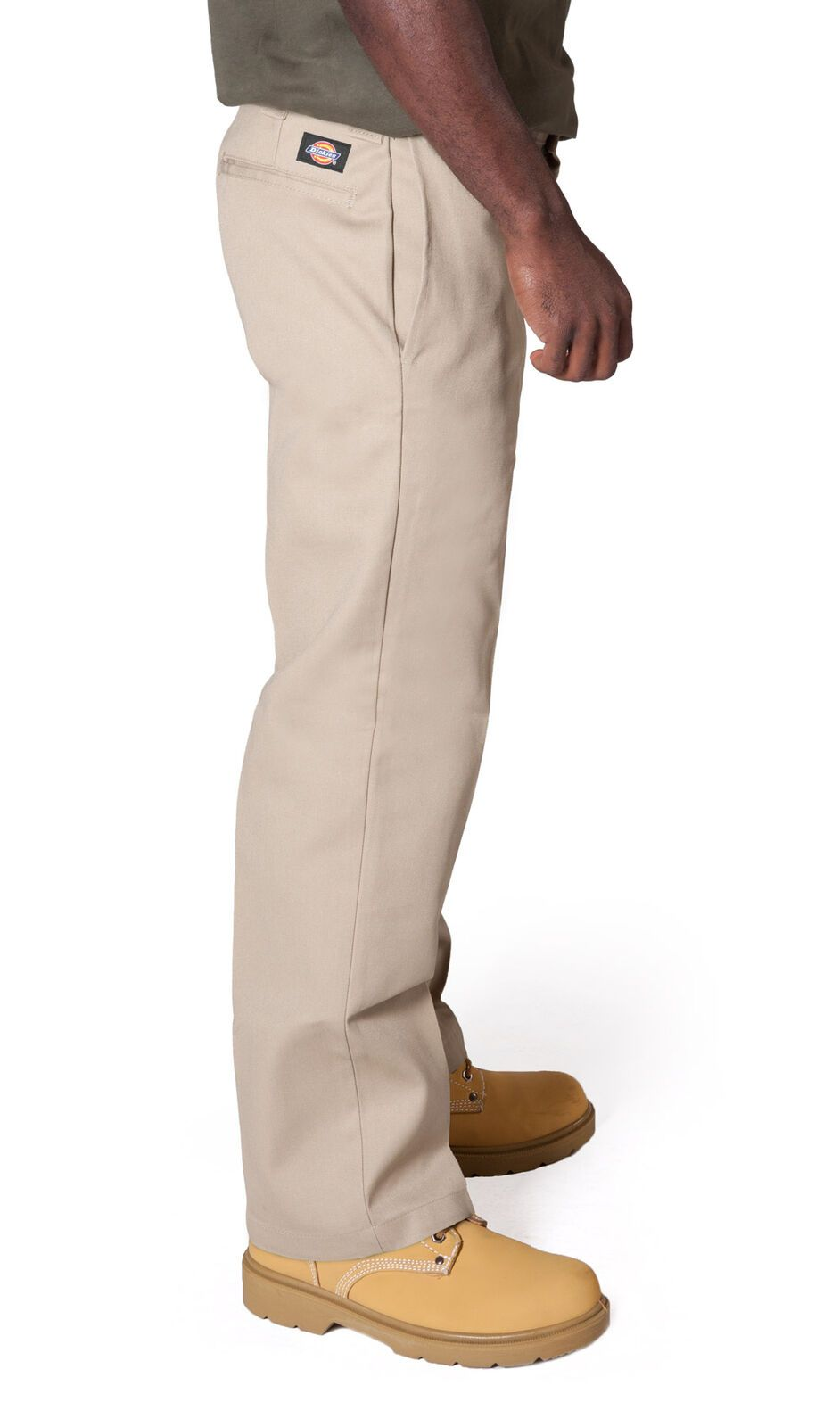 Close side view of slim and straight cut work trousers in khaki showing 'Dickies' logo, side pockets and belt loops.
