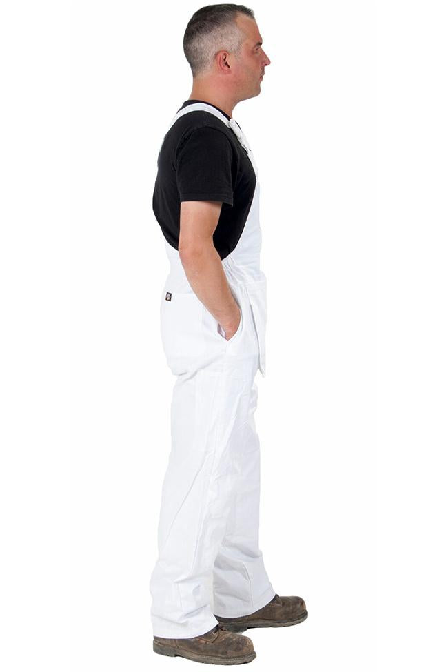 Full side pose with hands on side pockets of Dickies white work overalls.