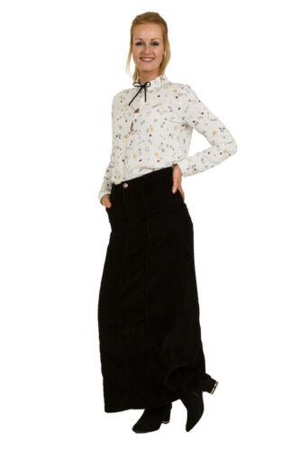 Angled frontal pose wearing 'Lisa' style long corduroy skirt with view of button fastening.