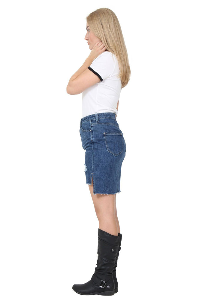 Full-length side view of 'Chloe' denim skirt showing belt loops and both front and rear pockets and raw hem finish.