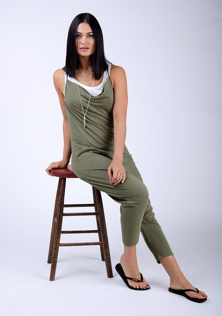 Sitting on stool wearing Cindy style jumpsuit.
