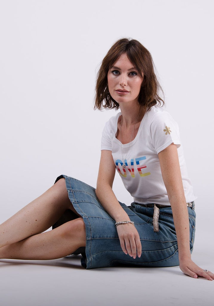 Sitting pose wearing Kim style soft panelled denim skirt demonstrating stretch.