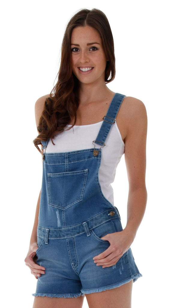 Top-half frontal of mid-weight denim bib-overall shorts with view of abrasions, front pockets and one-side zip and button fastening.