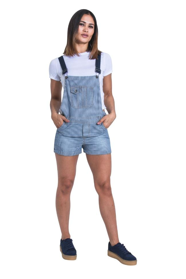 Full front view of model with hands in front pockets of 'Imogen' style, hickory stripe denim dungaree shorts from Dungarees Online.