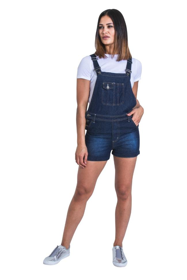 Full front view of model wearing women's 'Imogen' style, mid-blue denim dungaree shorts from Dungarees Online.
