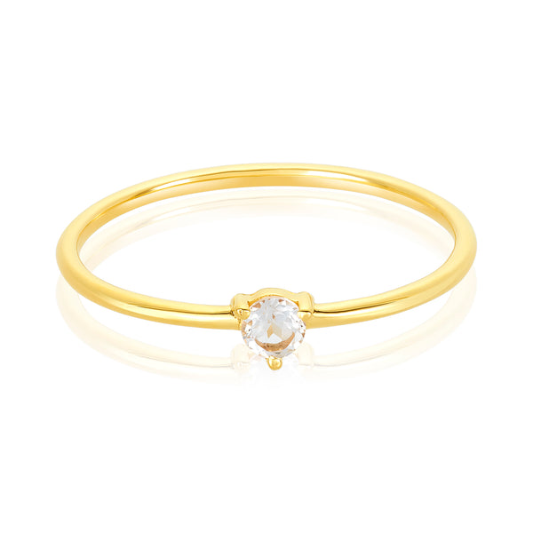 dainty ring made of 24 karat gold fill and white topaz